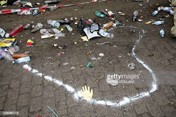 An outline of where a dead body lay can be seen at the entrance to the tunnel where panic broke out in a tunnel during the Loveparade in Duisburg...