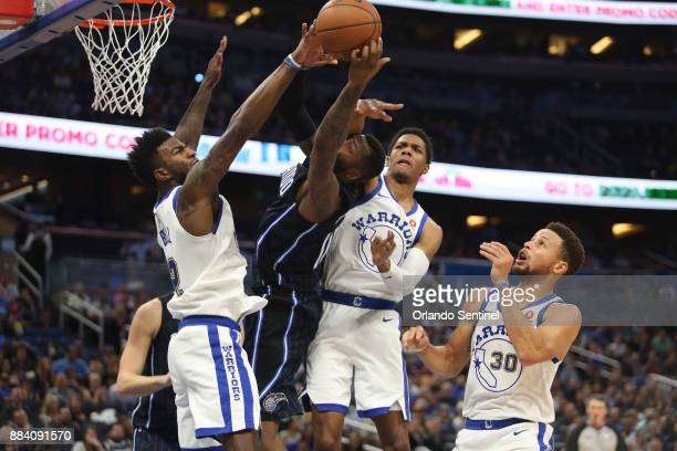 An outnumbered Orlando Magic forward Jonathon Simmons attempts a basket at Amway Center Friday Dec 1 2017 The Warriors beat the Magic 133112