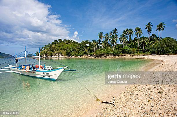 ISLAND PALAWAN PHILIPPINES An outrigger boat at the beach of Snake Island in the El Nido archipelago El Nido is considered as a showcase of Palawan's...