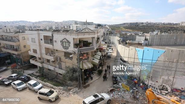 """An outside view of a hotel named """"The Walled Off"""" in Bethlehem in the southern West Bank, which is surrounded on all four sides by dividing wall, on..."""