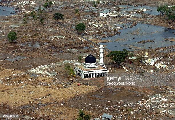 An over view shows a Muslim mosque amid rubble, in Teunom, 170 kms southwest from Banda Aceh, in Aceh province, Indonesia 02 January 2005, seven days...