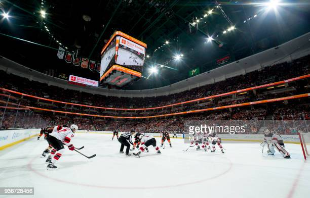 An overall view of a faceoff between Derek Grant of the Anaheim Ducks and Brian Boyle of the New Jersey Devils during the first period of the game at...