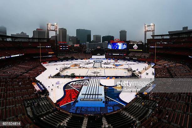 An overall view of Busch Stadium is veiled in fog and a barely visible St Louis Arch before the start of a NHL Winter Classic hockey game between the...