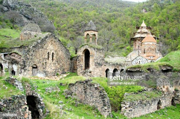 An overall view of the Dadivank monastery complex is seen May 6, 2004 in Nagorno-Karabakh, Azerbaijan. The main building on the right side is being...