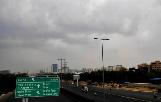 IND: Light Intensity Rain Bring Temperatures Down In Delhi-NCR