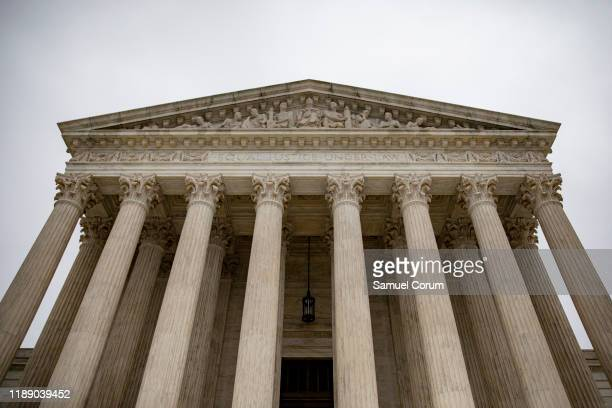 An overcast sky hangs above the US Supreme Court on December 16 2019 in Washington DC The Court is expected to release additional orders from the...
