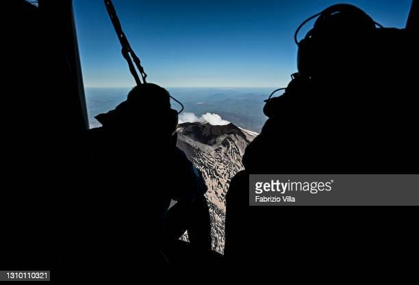 An overflight of Etna's summit craters by a helicopter from the Air Base, Air Nucleus and Helicopter Flight Section of the Catania Coast Guard, with...