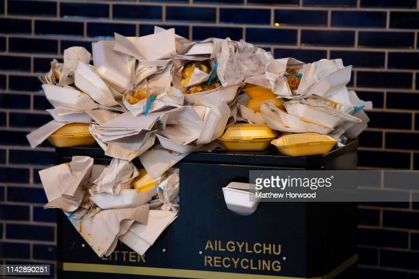 An overflowing bin full of takeaway food containers at night on December 22, 2018 in Cardiff, United Kingdom.