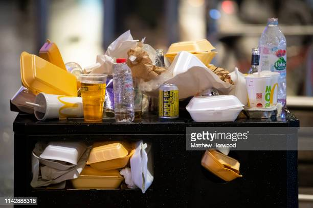 An overflowing bin full of takeaway food containers at night on March 16 2019 in Cardiff United Kingdom