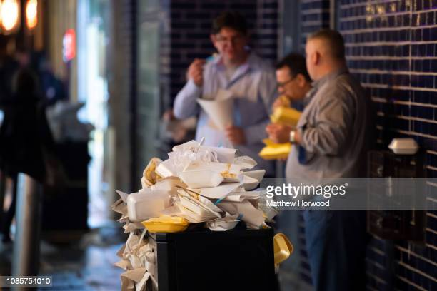 An overflowing bin stacked with takeaway food waste on Caroline Street on Black Friday on December 22, 2018 in Cardiff, United Kingdom. Black Friday,...