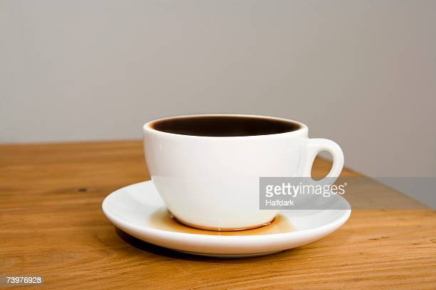 an overflowing coffee cup - saucer stock pictures, royalty-free photos & images