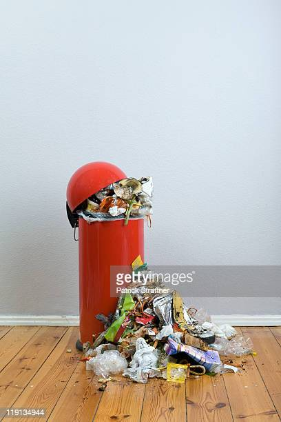 an overflowing garbage can of rotting food and recyclables - garbage can stock photos and pictures