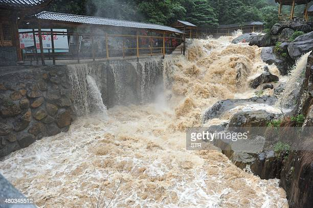 An overflowing river is seen during a heavy storm brought by typhoon Chanhom in Lin'an east China's Zhejiang province on July 11 2015 Typhoon Chanhom...