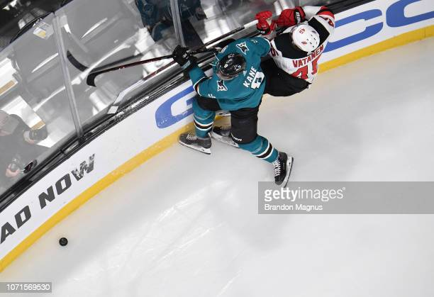 An overhead as Evander Kane of the San Jose Sharks collides with Sami Vatanen of the New Jersey Devils at SAP Center on December 10, 2018 in San...