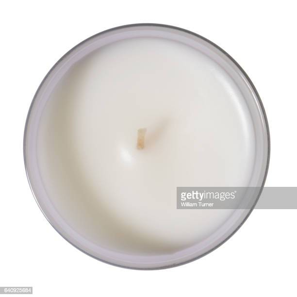 An overhead  cut out image of candle on a white background