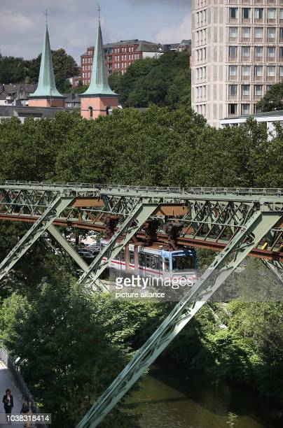 An overhead railway train travels through Wuppertal Germany 31 July 2015 Photo Oliver Berg/dpa | usage worldwide
