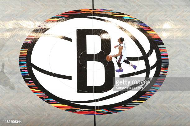 An overhead shot of Spencer Dinwiddie of the Brooklyn Nets dribbling the ball at center court during the game against the Boston Celtics on November...