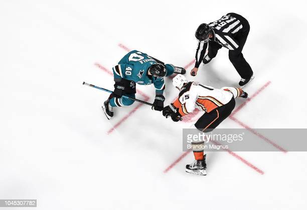 An overhead view as Antti Suomela of the San Jose Sharks and Ryan Getzlaf of the Anaheim Ducks fight for the puck at SAP Center on October 3 2018 in...