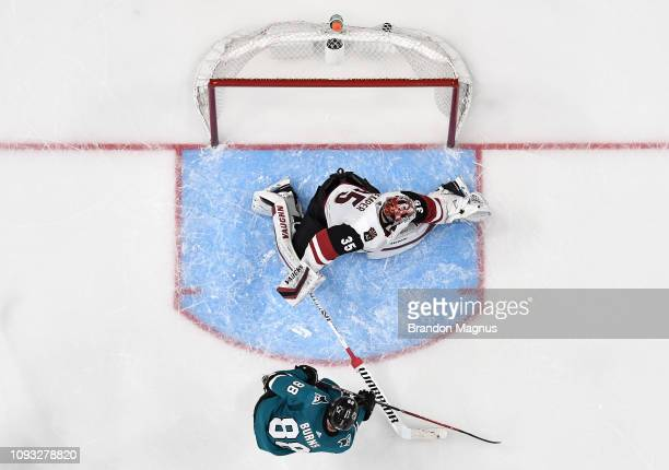 An overhead view as Brent Burns of the San Jose Sharks scores the gamewinning goal against Darcy Kuemper of the Arizona Coyotes at SAP Center on...