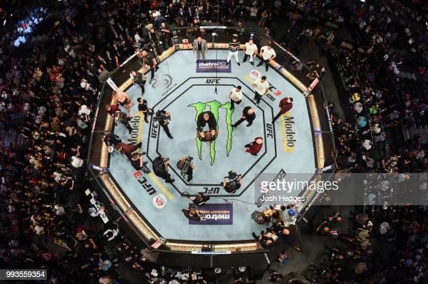 An overhead view as Brock Lesnar confronts Daniel Cormier after his UFC heavyweight championship fight during the UFC 226 event inside TMobile Arena...