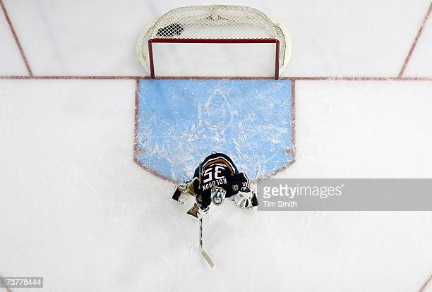 An overhead view as Goalie Dwayne Roloson of the Edmonton Oilers guards the net during the game against the Minnesota Wild at Rexall Place on March...