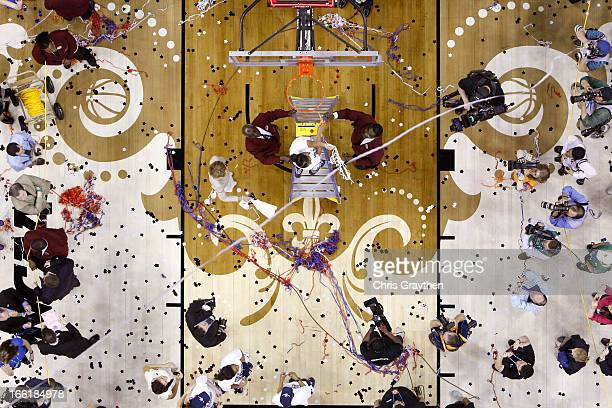 An overhead view as Kaleena MosquedaLewis of the Connecticut Huskies cuts down the net after defeating the Louisville Cardinals during the 2013 NCAA...