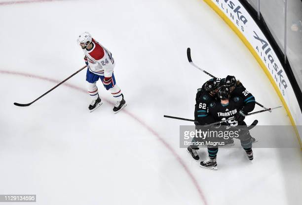 An overhead view as Kevin Labanc, Joe Thornton and Marcus Sorensen of the San Jose Sharks celebrate scoring a goal against the Montreal Canadiens at...