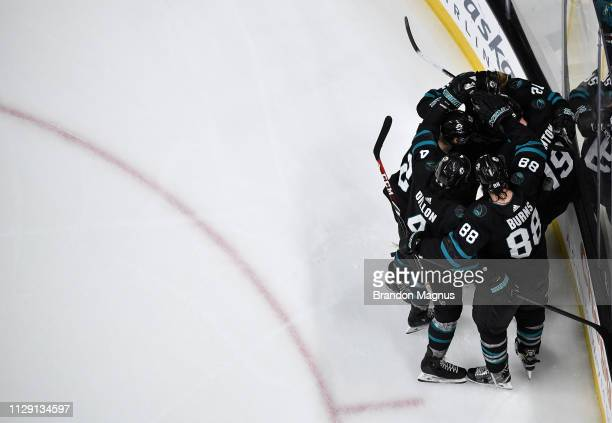 An overhead view as Kevin Labanc, Joe Thornton, Brent Burns and Marcus Sorensen of the San Jose Sharks celebrate scoring a goal against the Montreal...