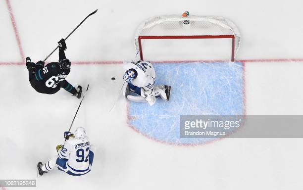 An overhead view as Kevin LaBanc of the San Jose Sharks drives to the net on Igor Ozhiganov and Frederik Anderson of the Toronto Maple Leafs at SAP...