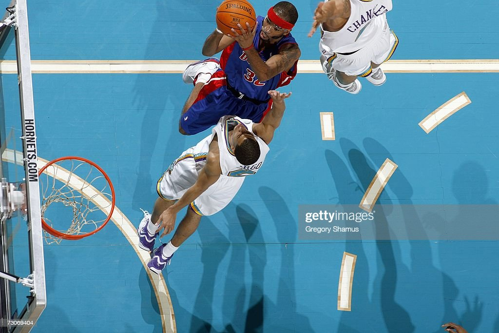 An overhead view as Richard Hamilton #32 of the Detroit Pistons puts up the shot against Jannero Pargo #2 of the New Orleans/Oklahoma City Hornets on January 4, 2007 at the Ford Center in Oklahoma City, Oklahoma.