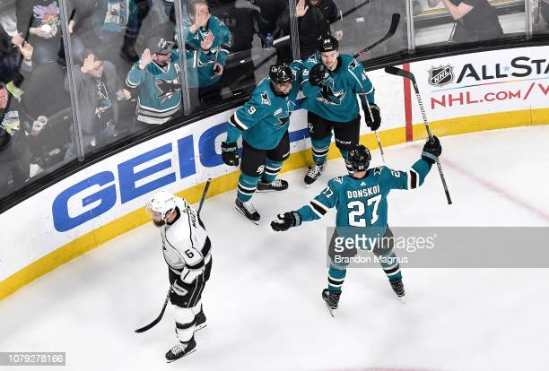 An overhead view as Tomas Hertl Jones Donakoi and Evander Kane of the San Jose Sharks celebrate after scoring against the Los Angeles Kings at SAP...