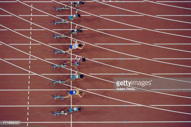 An overhead view from the start of the Women's 100 metres final featuring from top to bottom Tayna Lawrence Debbie Ferguson Merlene Ottey Ekaterini...