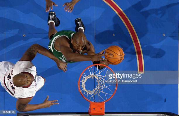 An overhead view of Center Vin Baker of the Boston Celtics as he looks to dunk against forward Derrick Coleman of the Philadelphia 76ers during the...