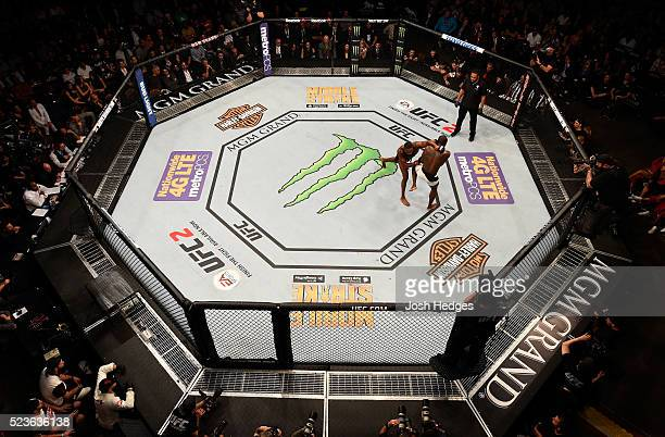An overhead view of Jon Jones punching Ovince Saint Preux in their interim UFC light heavyweight championship bout during the UFC 197 event inside...
