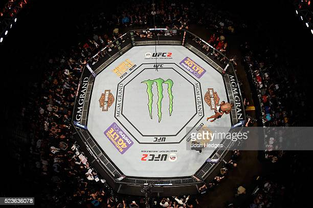 An overhead view of Jon Jones taking down Ovince Saint Preux in their interim UFC light heavyweight championship bout during the UFC 197 event inside...