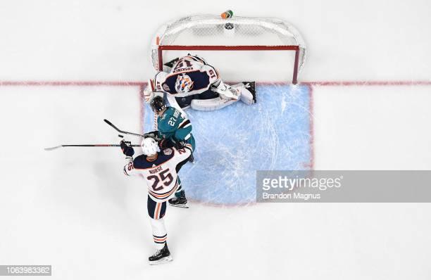 An overhead view of Joonas Donskoi of the San Jose Sharks crashing the net against Darnell Nurse and Mikko Koskinen of the Edmonton Oilers at SAP...