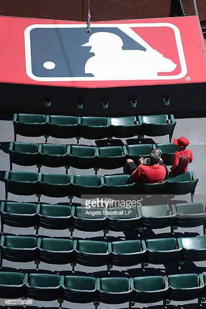 An overhead view of Los Angeles Angels of Anaheim fans sitting behind the MLB logo before the game against the Texas Rangers at Angel Stadium of...