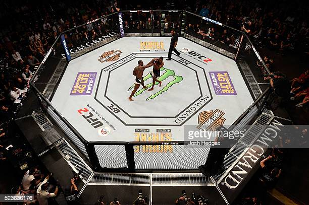 An overhead view of Ovince Saint Preux puncching Jon Jones in their interim UFC light heavyweight championship bout during the UFC 197 event inside...