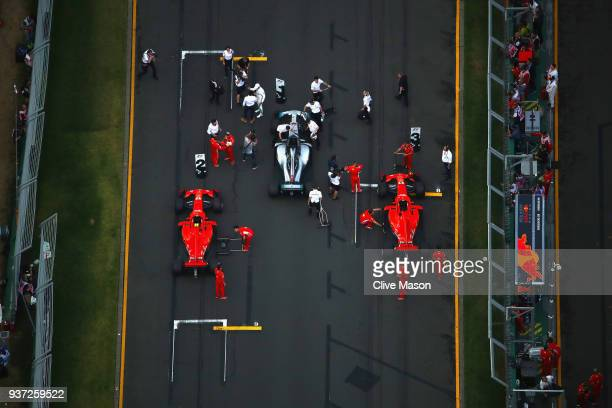 An overhead view of parc ferme showing the top three qualifiers Lewis Hamilton of Great Britain and Mercedes GP Kimi Raikkonen of Finland and Ferrari...