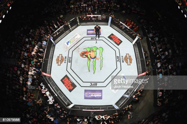 An overhead view of Robert Whittaker of New Zealand punches Yoel Romero of Cuba in their interim UFC middleweight championship bout during the UFC...