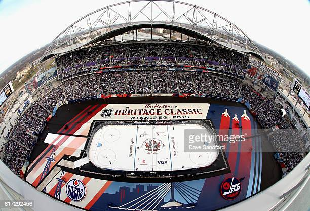 An overhead view of the 2016 Tim Hortons NHL Heritage Classic Alumni Game between the Edmonton Oilers alumni and the Winnipeg Jets alumni at...