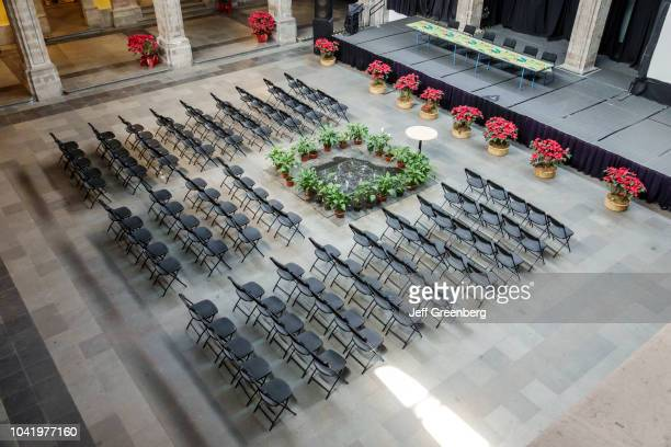 An overhead view of the central patio with folding chairs setup for an event at the Art Museum of the Ministry of Finance and Public Credit