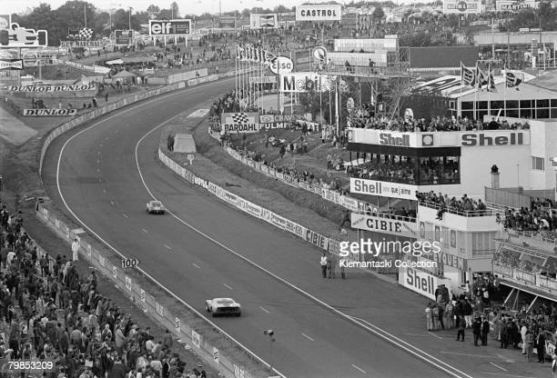 An overhead view of the end of the pit straight as cars sweep into the long uphill Dunlop Curve during the 24 Hours of Le Mans Le Mans September 2829...
