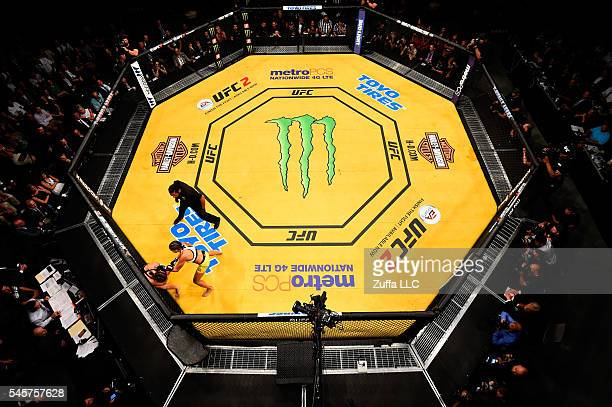 An overhead view of the Octagon as Amanda Nunes of Brazil punches Miesha Tate during the UFC 200 event on July 9 2016 at TMobile Arena in Las Vegas...
