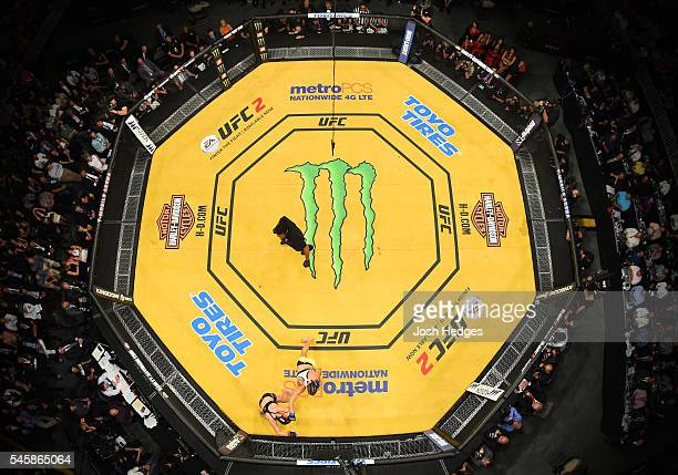 An overhead view of the Octagon as Amanda Nunes of Brazil punches Miesha Tate during the UFC 200 event at TMobile Arena on July 9 2016 in Las Vegas...