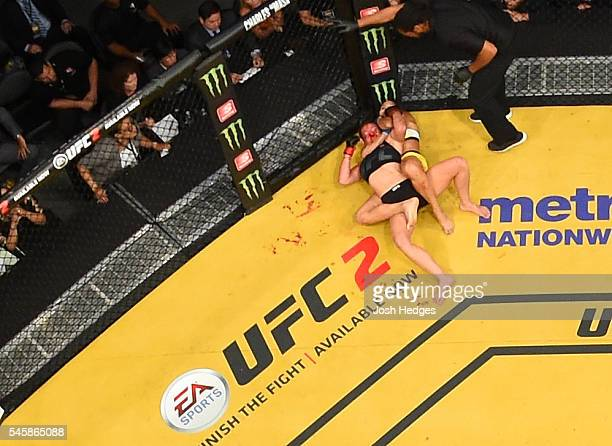 An overhead view of the Octagon as Amanda Nunes of Brazil secures a rear choke submission against Miesha Tate during the UFC 200 event at TMobile...