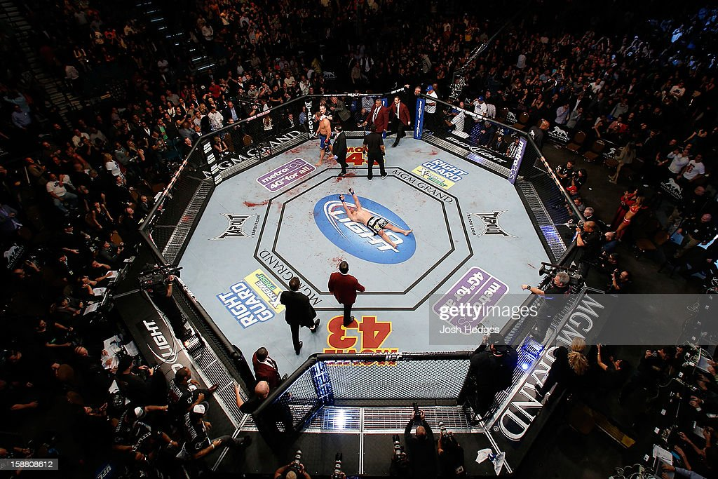 An overhead view of the Octagon as Cain Velasquez (black shorts) after his dominating performance against Junior dos Santos during their heavyweight championship fight at UFC 155 on December 29, 2012 at MGM Grand Garden Arena in Las Vegas, Nevada.