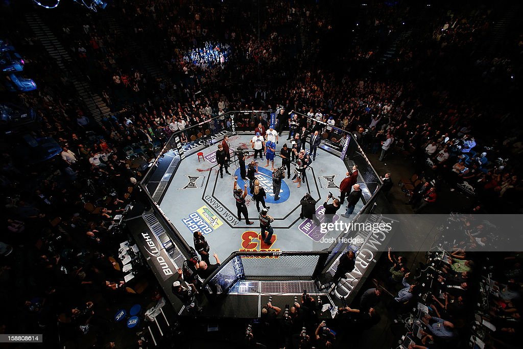 An overhead view of the Octagon as Cain Velasquez (black shorts) is crowned the new UFC heavyweight champion after defeating Junior dos Santos at UFC 155 on December 29, 2012 at MGM Grand Garden Arena in Las Vegas, Nevada.