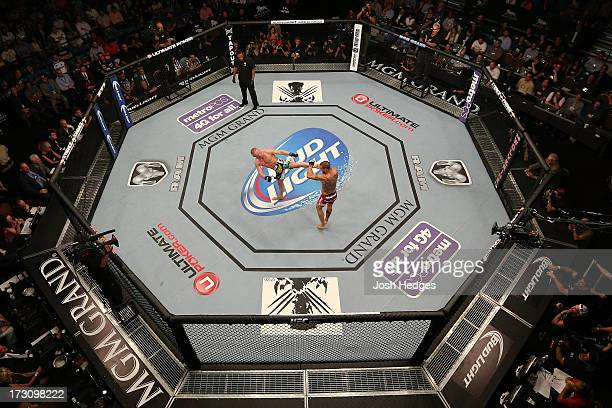 An overhead view of the Octagon as Dennis Siver kicks Cub Swanson in their featherweight fight during the UFC 162 event inside the MGM Grand Garden...