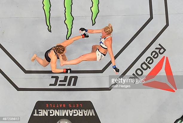 An overhead view of the Octagon as Holly Holm knocks out Ronda Rousey in their UFC women's bantamweight championship bout during the UFC 193 event at...